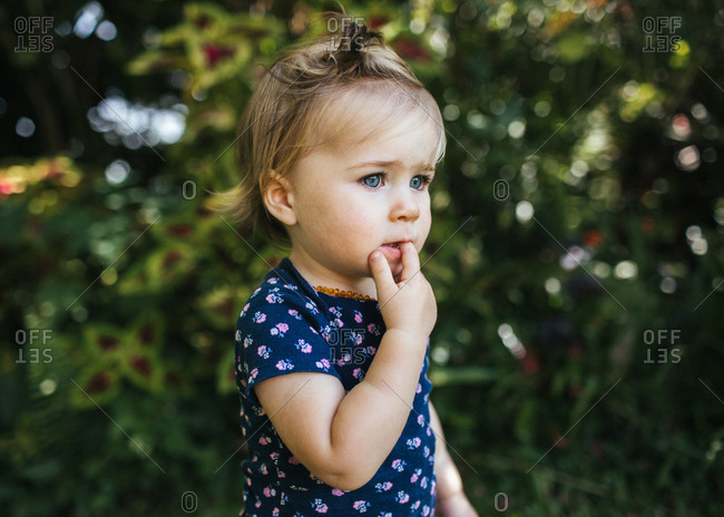 Baby girl wearing blue floral shirt