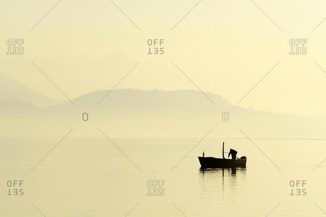 Fisherman on Lake Zug in the light of the setting sun, Canton of Zug, Switzerland, Europe