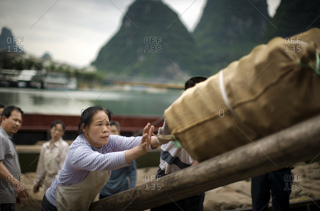 Chinese workers working loading cargo.
