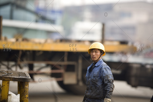 Portrait of a mid-adult construction worker at a shipping yard.