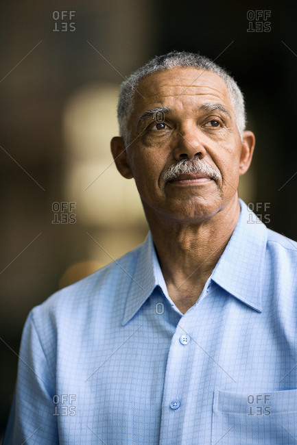 Mature man looking into the distance.