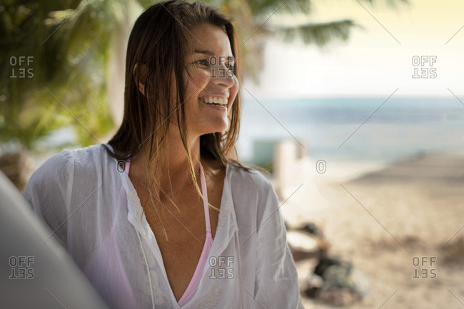 Smiling mid adult woman enjoying her vacation on a beach.