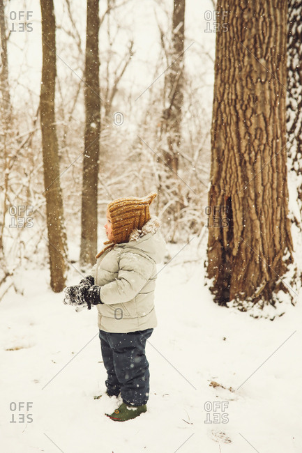 Toddler standing in snow - Offset