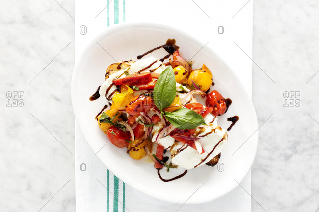 Colorful gourmet cheese and veggie dish