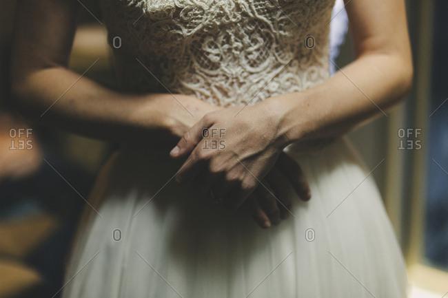 Bride holding hands together