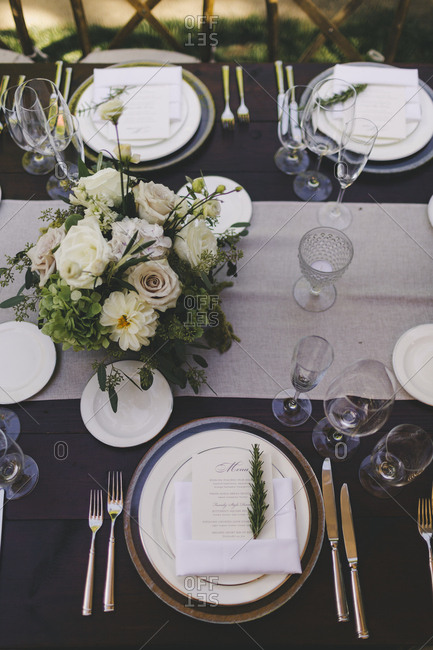Overhead view of set table at an outdoor wedding