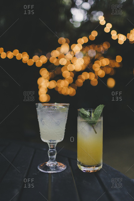 Cocktails with lights in background