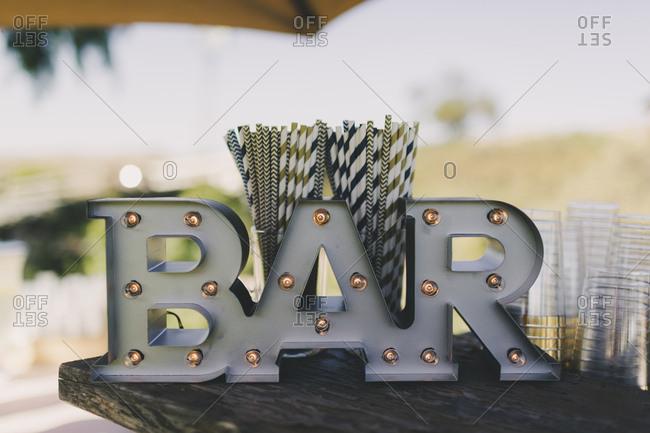 Illuminated bar sign at wedding