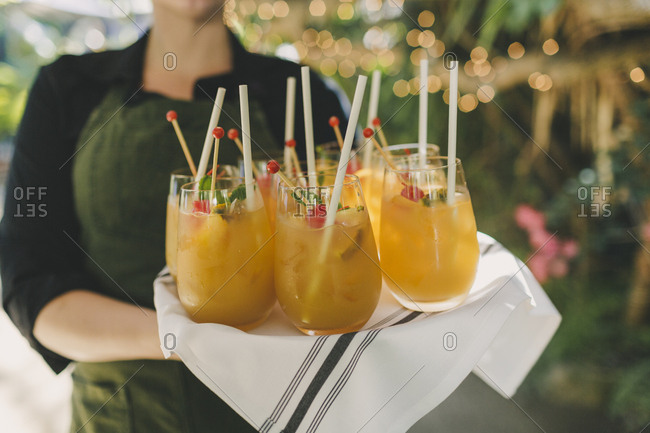 Woman serving fruity wedding cocktails