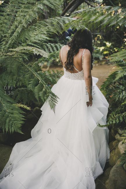 Bride walking through tropical forest