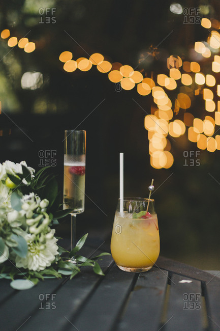 Cocktails and champagne with lights in background
