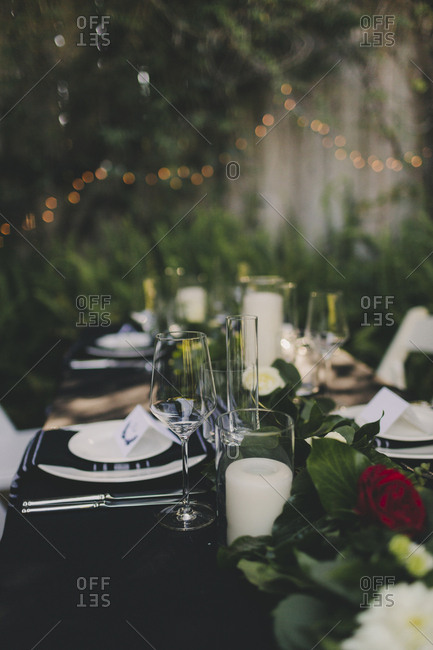 Black and white set table at an outdoor wedding