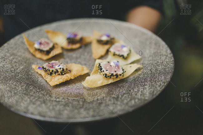 Woman serving wedding appetizers