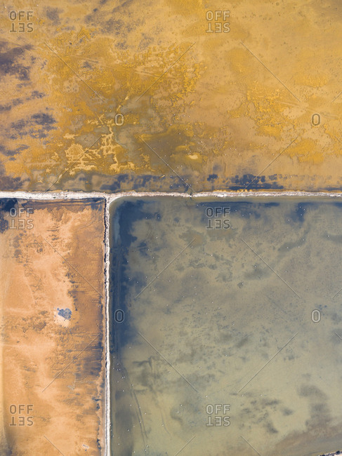 Drone view of colorful salt ponds in Spain