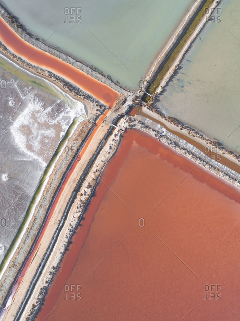 Overhead view of colorful salt ponds in Spain