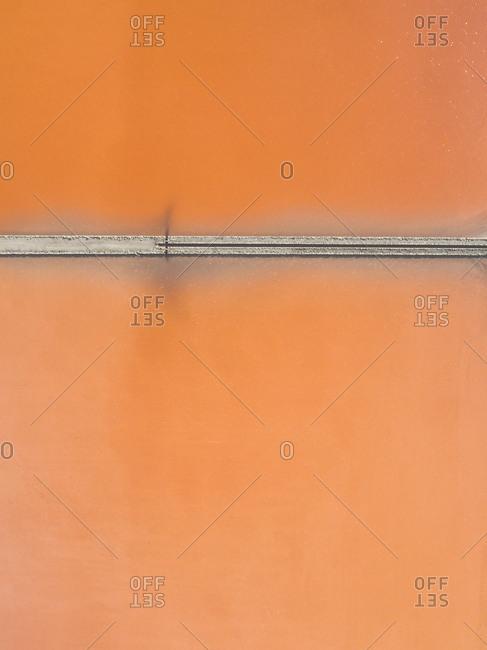 Aerial view of orange salt ponds in Spain