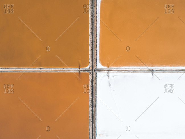 Orange and white salt ponds in Spain from above