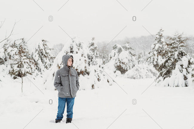 Portrait of a young adolescent boy outside in winter