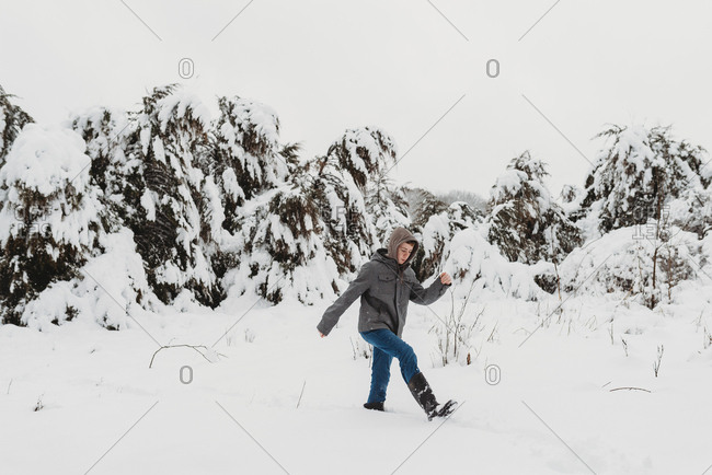 Young adolescent boy walking outside in winter