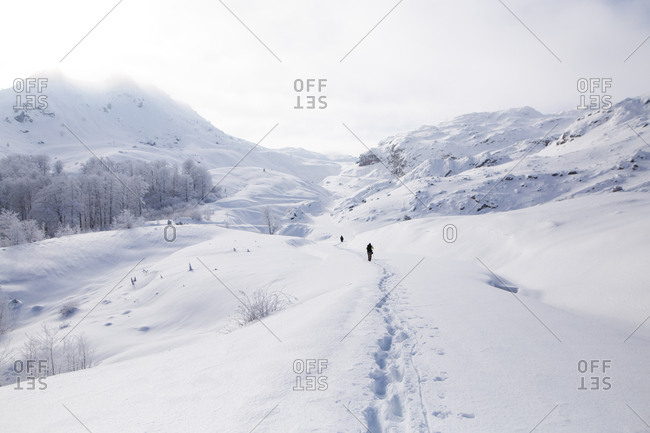 People hiking on Visocica Mountain in winter
