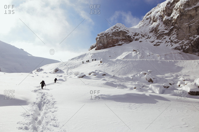 Group hiking on Visocica Mountain in winter