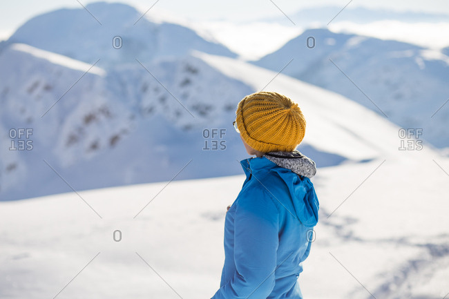 Woman taking in view while hiking on Visocica Mountain