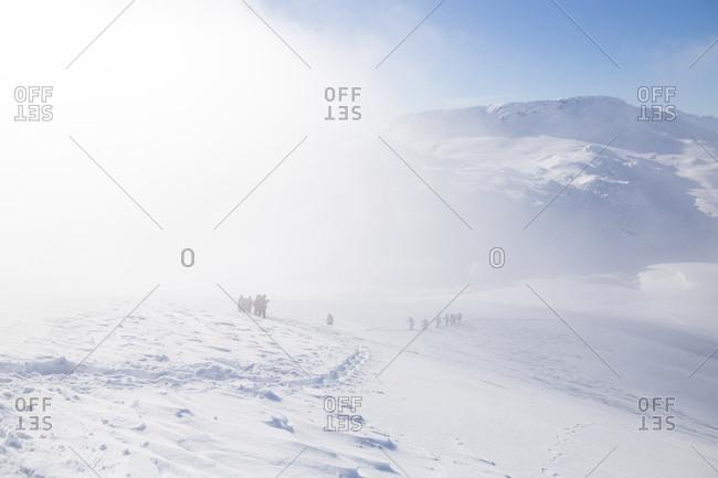 Group hiking through snow on Visocica Mountain