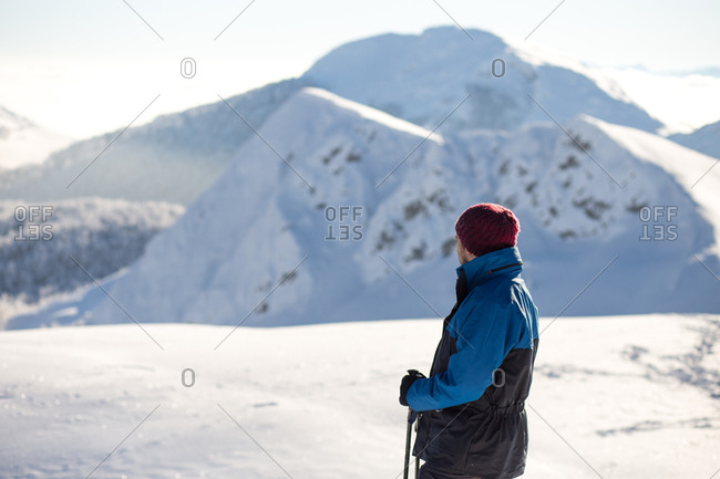 Man taking in view while hiking on Visocica Mountain in winter