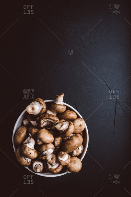 Bowl of mushrooms on a dark background