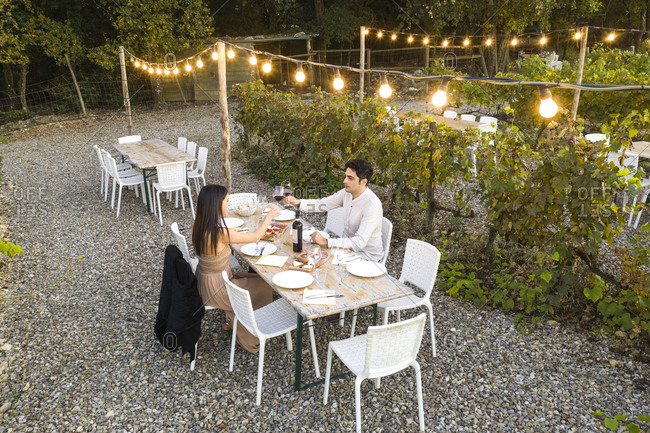 Italy- Tuscany- Siena- young couple having dinner in a vineyard