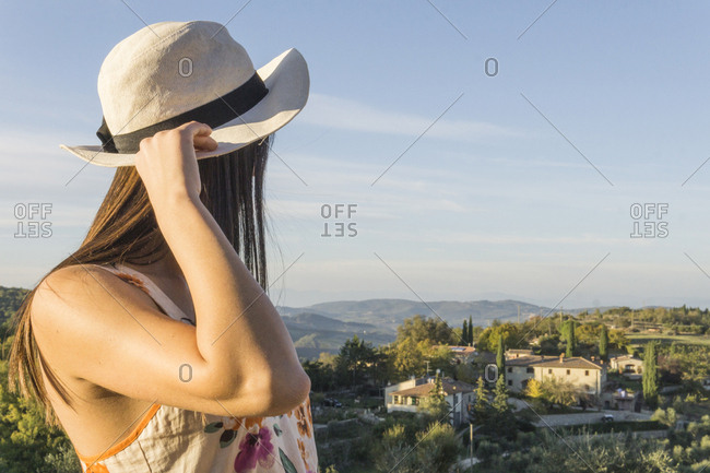 Italy- Tuscany- Siena- young woman enjoying the view at a winery
