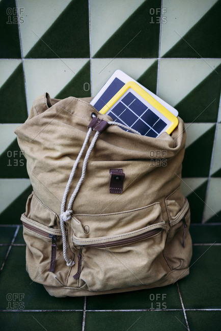 Solar panel charger and a tablet in a backpack