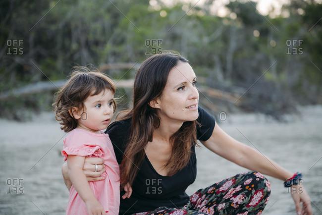 Australia- Queensland- Mackay- Cape Hillsborough National Park- mother and daughter exploring the beach