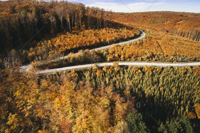 Austria- Lower Austria- Vienna Woods- Exelberg- aerial view on a sunny autumn day over a winding mountainroad