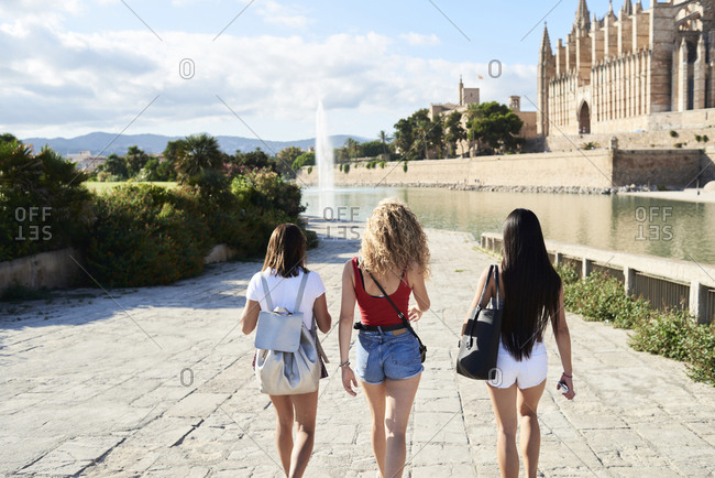 Spain- Mallorca- Palma- rear view of three young women exploring in the city