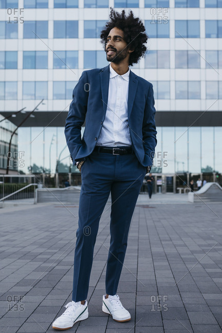 Spain- Barcelona- stylish young businessman standing in the city