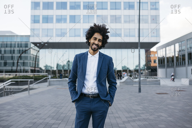 Spain- Barcelona- portrait of stylish young businessman standing in the city