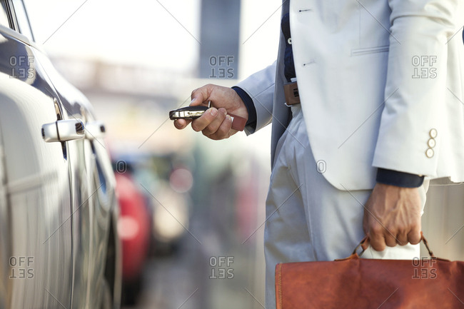 Businessman unlocking his car- close up
