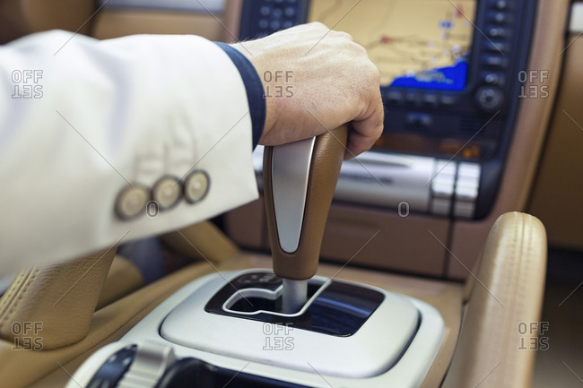 Hand of a businessman on the gearshift