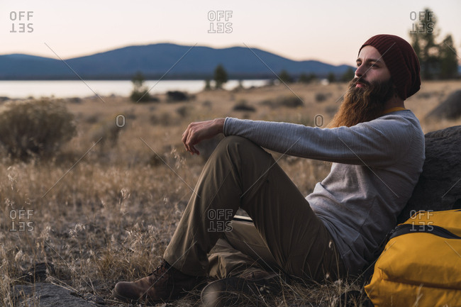 USA- North California- bearded young man having a break on a hiking trip near Lassen Volcanic National Park