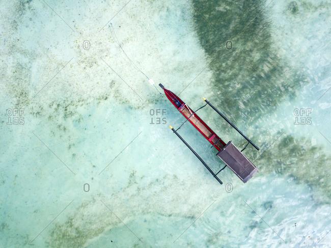 Indonesia- Sumbawa- West Sumbawa- Aerial view of banca boat