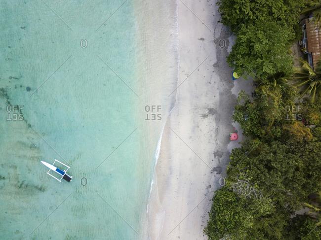 Indonesia- Sumbawa- West Sumbawa- Aerial view of banca boat and Jelengah beach