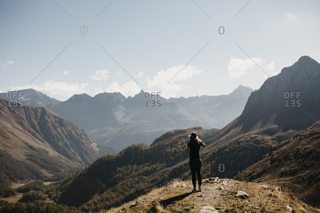 Switzerland- Engadin- woman standing in mountainscape