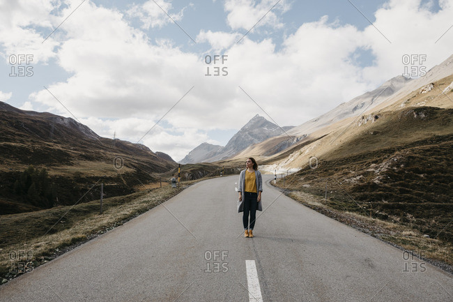 Switzerland- Engadin- woman standing on mountain road