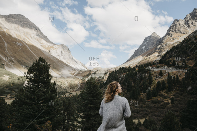 Switzerland- Grisons- Albula Pass- woman standing in mountainscape