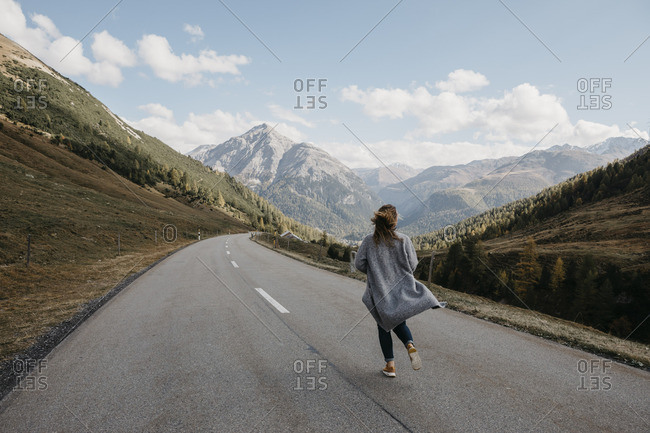Switzerland- Engadin- rear view of woman walking on mountain road