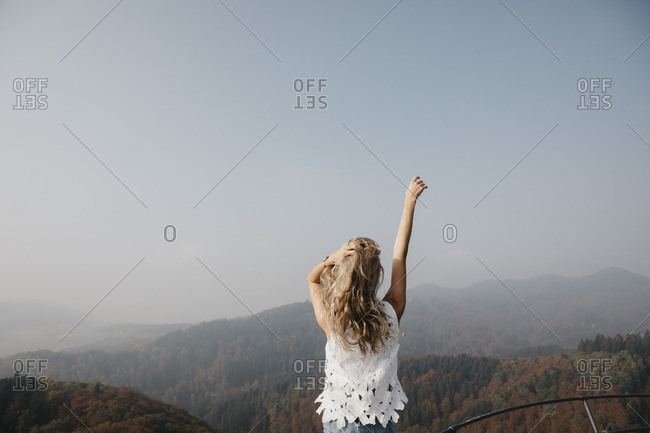 Germany- Black Forest- Sitzenkirch- young woman enjoying the view of mountain forest
