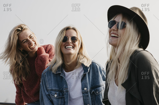 Three happy young women outdoors