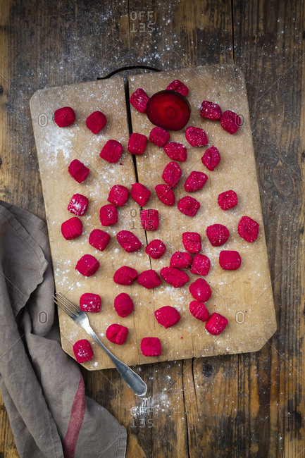 Beetroot gnocchi on chopping board