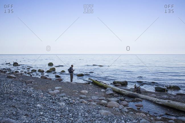 Germany- Mecklenburg-Western Pomerania- Ruegen- Jasmund National Park- hiker at the beach